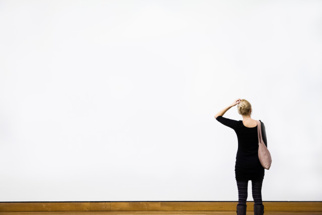 blank-wall-woman-wondering-640x428